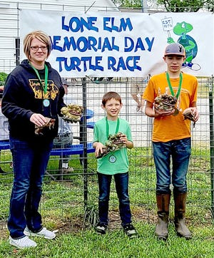 The 45th Annual Lone Elm Turtle Race had a great turnout. Out of 141 turtles this year the winners were: (left to right) 1st Place - Kelley McDonald (Timm), 2nd Place - Collin Young and 3rd Place - Cooper Brown.