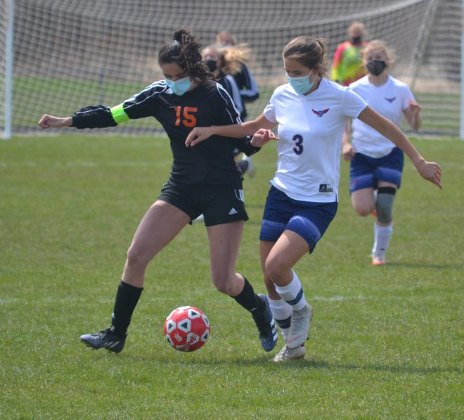 Cheboygan senior Kayla Burt, left, played her final game with the girls soccer program in a district final loss to Boyne City in Elk Rapids on Friday.