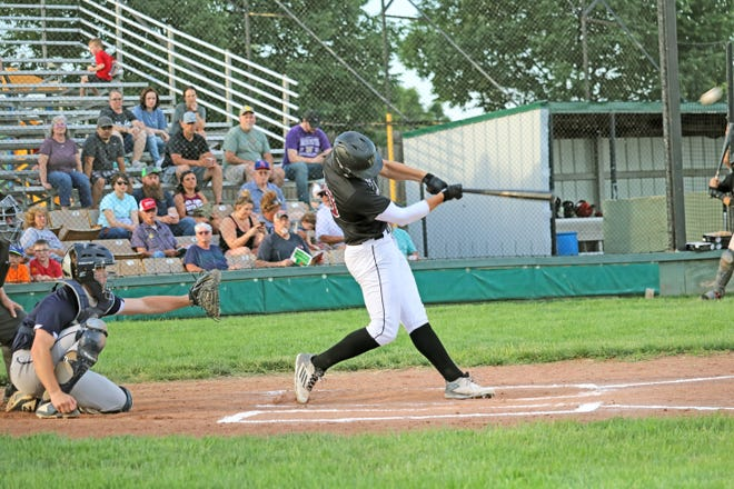 """The ball is about to leave the camera frame at a favorable """"launch angle"""" on its way to leaving """"Chuck"""" Haney Field at """"June"""" Shaffer Memorial Park Stadium for a solo home run for Josh Swinehart of the Chillicothe Mudcats in the first inning of last Saturday's home game against the Queen City Crush of Springfield. Swinehart hammered another pitch over the left field wall in the sixth inning, making him the first Mudcat ever to hit two homers out of Shaffer Park Stadium in the same game in the team's 19-years history."""