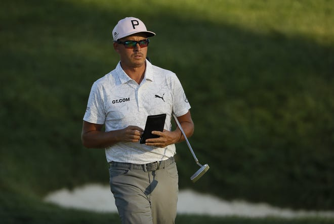 Rickie Fowler walks away from the 17th green during the second round of the Memorial Tournament at Muirfield Village Golf Club in Dublin, Ohio on Friday, June 4, 2021.