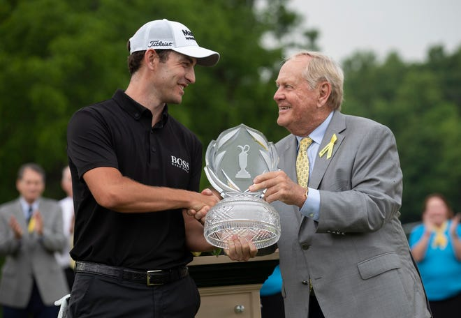 Patrick Cantlay receives the trophy for winning the Memorial Tournament from Jack Nicklaus following his playoff win over Collin Morikawa at Muirfield Village Golf Club in Dublin, Ohio on Sunday, June 6, 2021.