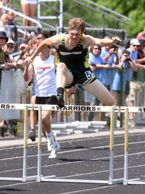 Shenandoah's Max McVicker runs to a runner-up finish in the 300 intermediate hurdles on Saturday during the finals of the Division III state track and field meet at Westerville North. McVicker ran a :40.09.