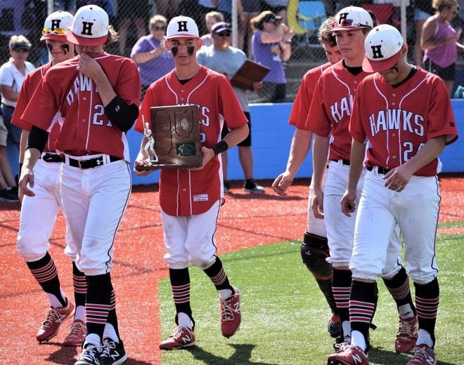 Hiland seniors Casey Lowe (from left), Derrick Troyer, Jarred Hostetler, Isaiah Miiler, Reece Schlabach and Collin Lowe walk dejectedly back to the dugout with the Div. IV Lancaster Regional runner-up trophy after falling 5-2 to Valley.
