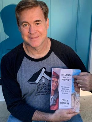"""Author Peter Cozzens holds his latest book, """"Tecumseh and the Prophet: The Shawnee Brothers Who Defied a Nation."""" Cozzens will speak about the book during a virtual presentation from 7 to 8 p.m. Tuesday, June 8, hosted on the Tecumseh District Library's Facebook page."""