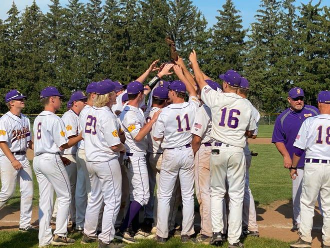 The Blissfield baseball team celebrates with the trophy after defeating Hudson 18-16 to win the Division 3 district championship at Onsted on Saturday evening.