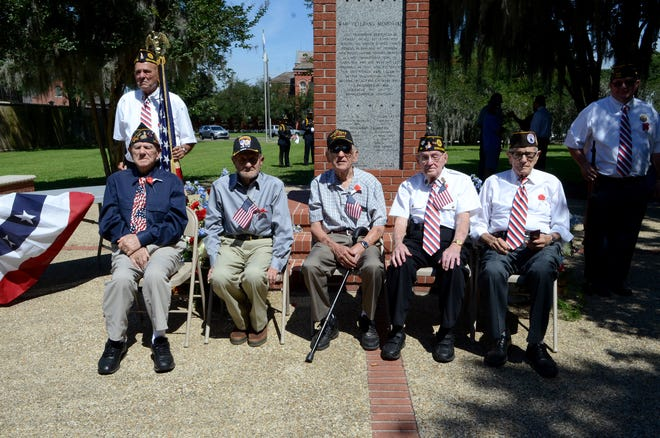 """World War II veterans attended the Memorial Day ceremony held May 31 in Donaldsonville. Pictured are: Virgil """"Rip"""" Joffrion, Odon """"Kiki"""" Templet, Floyd Ourso, Tip Torres, and Wilson Waguespack. Standing are Richard Bouchereau and Maurice Wirth."""