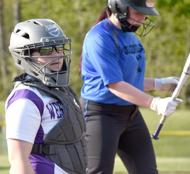 West Canada Valley catcher Maggie Burdick (left) checks with her coaches in the dugout for a sign during a May 18 game against Dolgeville. The Indians travel to Thousand Islands for the first round of sectional play Monday.