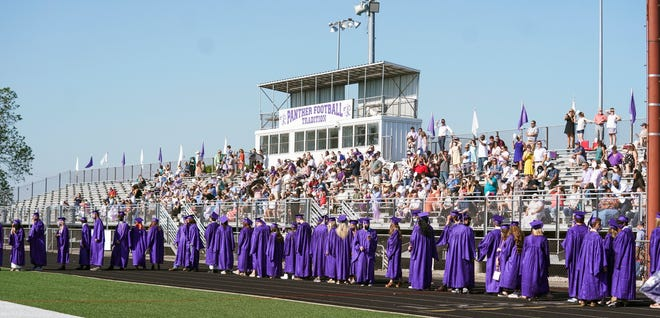 Graduates line up on the stadium track Saturday morning during the Bloomington High School South graduation ceremony.