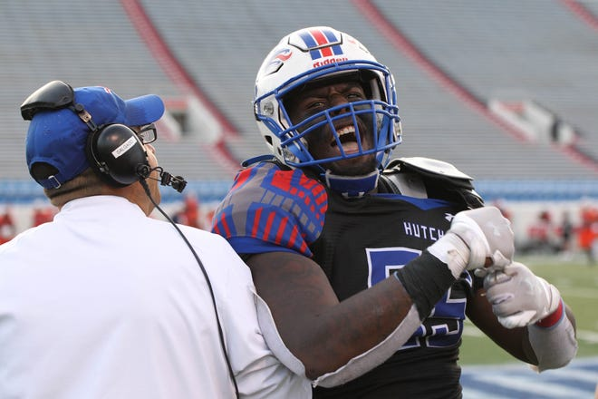 Hutchinson CC's Daishon Folsom celebrates as the time winds down in the NJCAA football national championship in Little Rock, Arkansas. The Blue Dragons beat the Snow College Badgers 29-27.