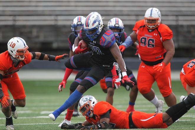 Hutchinson CC's Tye Edwards breaks a tackle for a 68-yard touchdown in the first half of the NJCAA football national championship in Little Rock, Arkansas. The Blue Dragons beat the Snow College Badgers 29-27.
