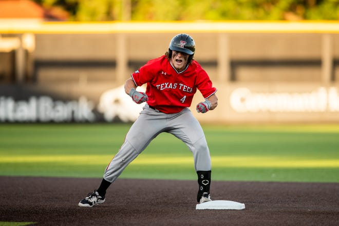 Texas Tech's Dru Baker celebrates after hitting a leadoff double in the first inning of a NCAA Lubbock Regional game Saturday, June 5, 2021, against North Carolina at Dan Law Field at Rip Griffin Park.
