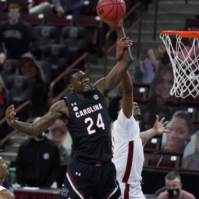South Carolina forward Keyshawn Bryant (24) is fouled by Alabama forward Herbert Jones (1) during the first half in February. After declaring for the NBA draft, Bryant has decided to return to South Carolina for his senior year.