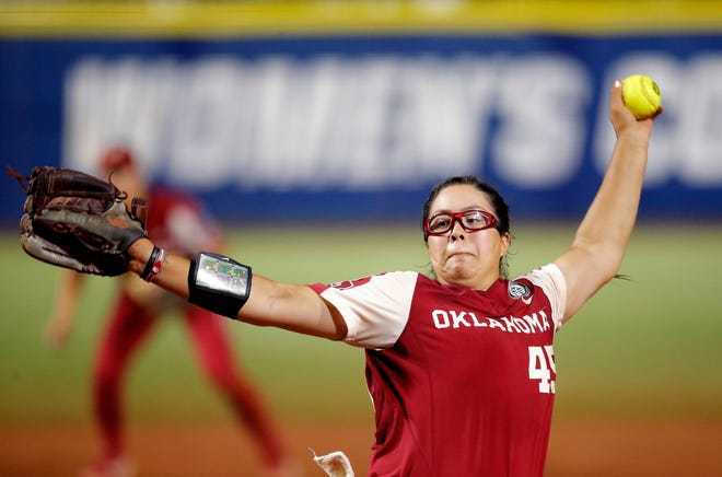 Oklahoma's Giselle Juarez (45) throws a pitch in the seventh inning of a Women's College World Series softball game between Oklahoma and UCLA at the USA Hall of Fame Stadium in Oklahoma City, Saturday, June 5, 2021.