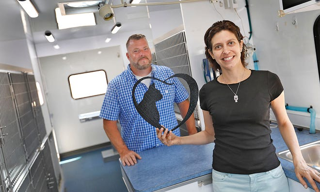 Jennifer Inzana-Young and husband Charlie with Jennifer's new mobile animal hospital which will be used to spay and neuter cats and dogs. Jennifer of Weymouth is fighting stage four cancer and decided to but positive energy into her passion for animals  with the purchase of the van on Sunday June 6, 2021 Greg Derr/The Patriot Ledger