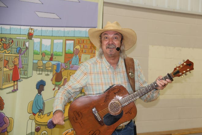 Singing cowboy Marshall Mitchell entertained children last Wednesday morning at Pawhuska Elementary School. Mitchell's performance was an element of the Pawhuska Library's Summer Reading Program for 2021. Summer Reading sessions are scheduled every Wednesday this month.