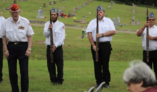 American Legion Post 198 of Pawhuska took part in Memorial Day observances at the local cemetery. Here, several men prepare to fire a salute to those who gave their lives for this country.