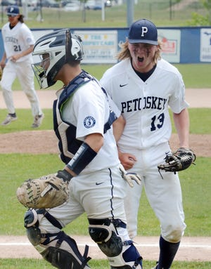 Petoskey's Stephen McGeehan (13) celebrates after getting the final out with catcher Kolton Horn (left) against Gaylord.