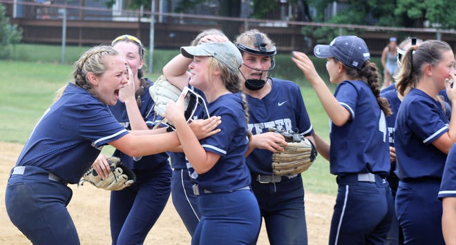 Members of the Exeter High School softball team react after beating Winnacunnet, 4-3 in a Division I quarterfinal game on Saturday.