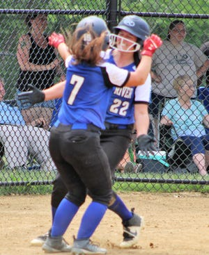 Oyster River's Hailey Davis (7) greets Madla Walsh (22) at home plate after Walsh scored the game-winning run in the bottom of the 11th inning of Oyster River's 1-0 win over Pembroke in a Division II quarterfinal.