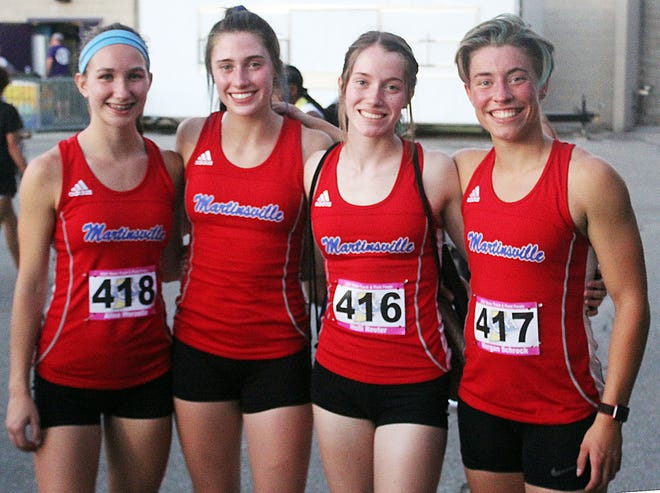 One more time: As they have all during the postseason, Martinsville's 4x400-meter relay teammates gather for pictures following Saturday's IHSAA State Finals at Ben Davis. They are (from left) Alina Worzella, Hanna Reuter, Holli Reuter and Morgan Schrock. (Steve Page / Correspondent)