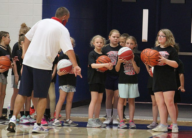 Martinsville coach Dave Dorsett instructs campers to work on dribbling with their left hand during last week's camp. (Melissa Dillon/Correspondent)