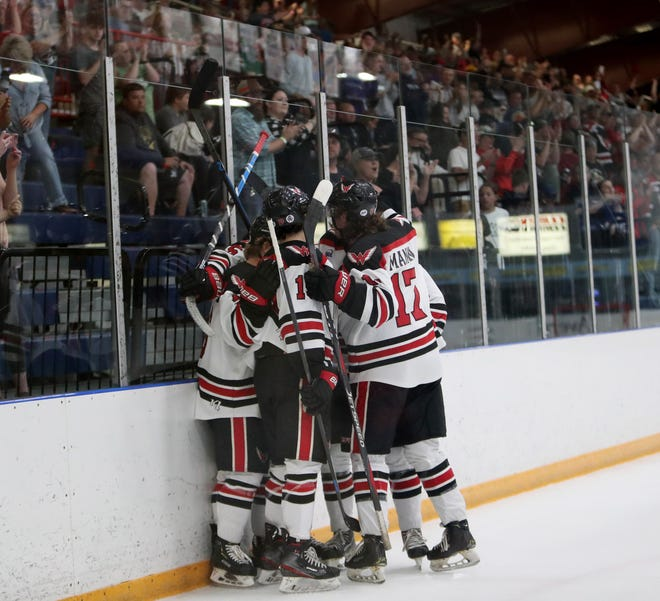 Aberdeen Wings winger Thomas Manty celebrates with his teammates following his goal during the first period against the Bismarck Bobcats in Saturday's Game Two in the Central Division Finals. American News photo by Jenna Ortiz, taken 06/05/2021.