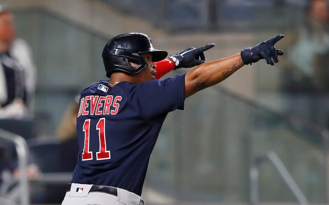 Boston Red Sox's Rafael Devers celebrates after scoring against the New York Yankees during the Sox's 7-3 win Saturday in New York.