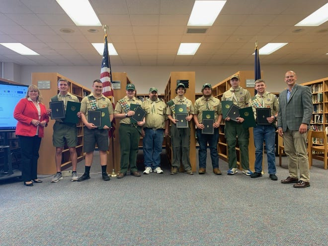 Seven seniors from Berlin Brothersvalley High School received their Eagle Scout status and were recognized at the Berlin Brothersvalley school board meeting May 6, by Sen. Pat Stefano and Somerset County Commissioner Colleen Dawson. They are from left: Commissioner Colleen Dawson, Keegan Huston, Nathan Leonard, Zachary Krepelka, Scoutmaster Daniel Delancy, Graham Hoover, Randy Delancy, Abe Countryman, Tucker Patrick and Sen. Pat Stefano.