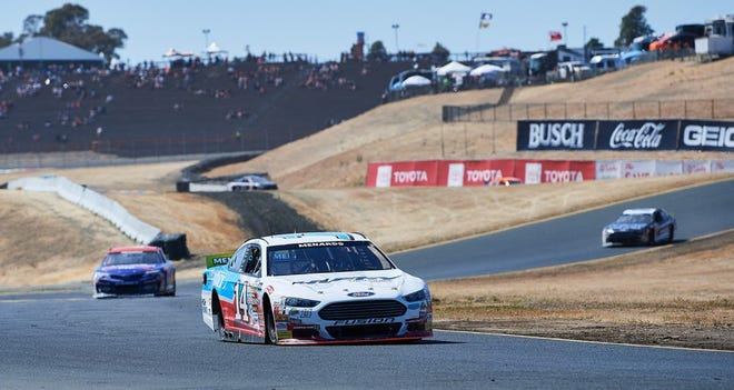 Mitchell's Chase Briscoe (14) leads the field through a chicane while winning the ARCA West Series road race at Sonoma Raceway Saturday.