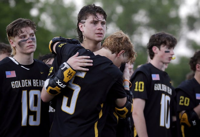 Chris Mazzaferri (5) and Tanner Gillie console each other while Leo Caine (19) watches Dublin Jerome accept its championship medals and trophy following Upper Arlington's 12-11 loss to the Celtics in the Division I state final June 5 at Ohio Wesleyan.
