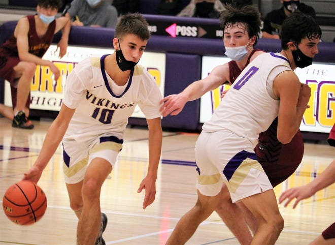 North Kitsap's Cade Orness dribbles around a screen during Saturday's playoff victory against Kingston.
