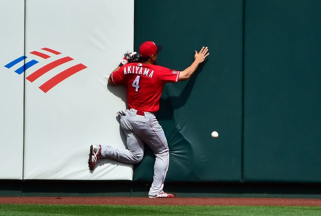 Jun 6, 2021; St. Louis, Missouri, USA;  Cincinnati Reds center fielder Shogo Akiyama (4) slams in to the wall trying to catch a two run double by St. Louis Cardinals pinch hitter Matt Carpenter (not pictured) during the sixth inning at Busch Stadium. Mandatory Credit: Jeff Curry-USA TODAY Sports
