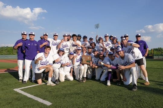 Cincinnati Hills Christian Academy's team celebrates after defeating Cincinnati Country Day School 5-1 during an OHSAA Division III Regional Final on Saturday, June 5, 2021, in Dayton, Ohio.