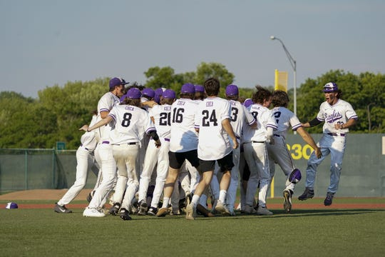 Cincinnati Hills Christian Academy players celebrate after winning 5-1 against Cincinnati Country Day School during an OHSAA Division III Regional Final on Saturday, June 5, 2021, in Dayton, Ohio.