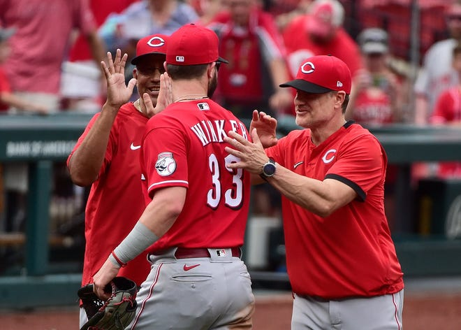 Jun 6, 2021; St. Louis, Missouri, USA;  Cincinnati Reds left fielder Jesse Winker (33) celebrates with manager David Bell (25) after the Reds defeated the St. Louis Cardinals at Busch Stadium. Mandatory Credit: Jeff Curry-USA TODAY Sports