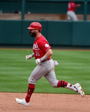 Jesse Winker  celebrates after hitting what proved to be a game-winning solo home run off Cardinals closer Alex Reyes  in the ninth inning at Busch Stadium Sunday.