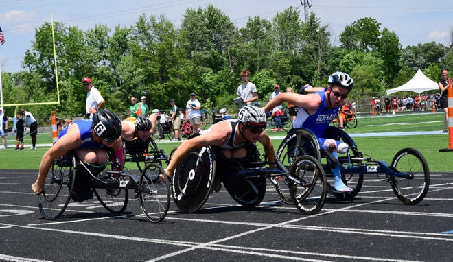 Anthony Wayne's Aiden Green, Carrollton's Jacob Baker of and Waynedale's Elijah Yoder finish 1-2-3 in the boys 100-meter seated race at the 2021 OHSAA State Track and Field Championships.