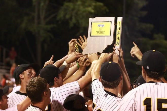 Jasper players celebrate the Wildcats' Class 4A regional title on Saturday night.