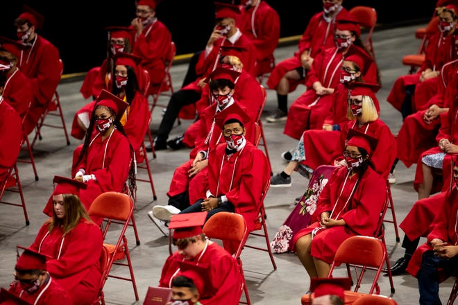 Most students remained masks while sitting during the Green Bay East High School 2021 commencement ceremony  June 6 at the Resch Center in Green Bay.