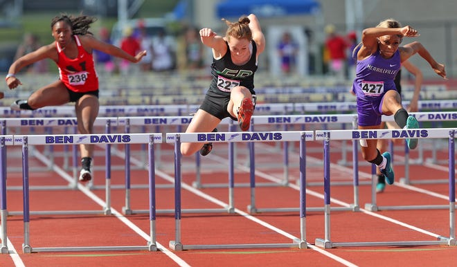 Forest Park's Rachel Mehringer, center hurdles with Merrillville's Jordan Yanders, right, keeps close in the 100 meter hurdles during the IHSAA girls track and field state finals Saturday, June 5, 2021 at Ben Davis High School in Indianapolis.