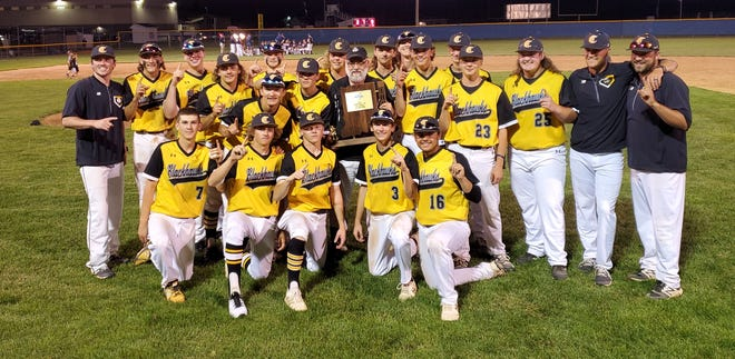Cowan's baseball team poses for a picture with the regional championship trophy after beating Riverton Parke 9-3 at Carroll (Flora) High School Saturday, June 5, 2021.
