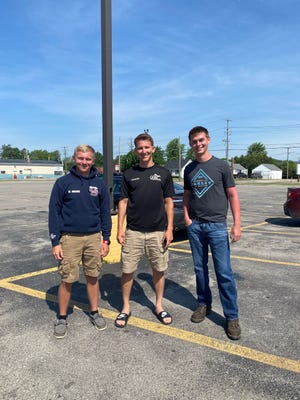 (from left): Off-duty firefighter Matthew Washe and his friends, Quentin Hooper and Connor Erbe helped save a couple whose boat had capsized in Lake Huron Saturday, June 5, 2021.