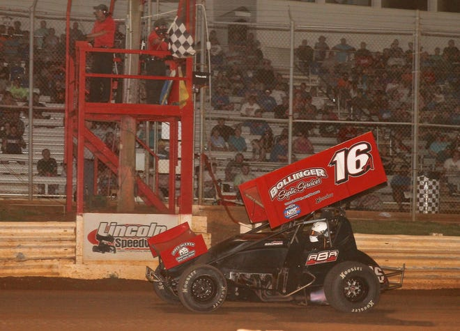 Aaron Bollinger takes the checkered flag at Lincoln Speedway on Saturday night.