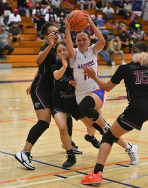 Westlake's Mariah Elohim tries to get past three Paloma Valley defenders during a CIF-Southern Section Division 2A semifinal game at Westlake High on Saturday night. The Warriors lost, 61-45.