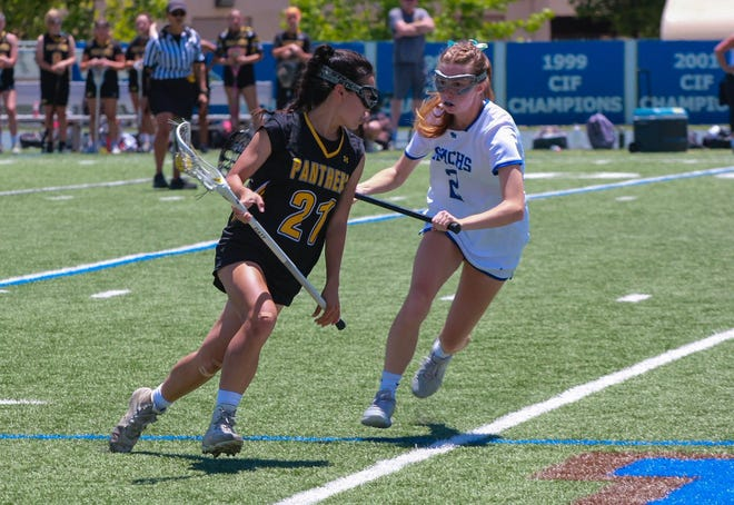 Newbury Park junior Cassie Huber is defended by Santa Margarita Catholic's Lily Matteson in the CIF-Southern Section Division 1 semifinals on Saturday afternoon in Rancho Santa Margarita