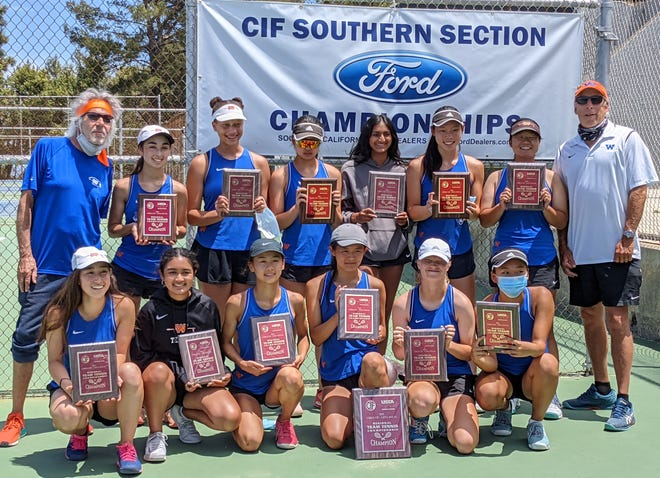 The Westlake High girls tennis team poses with its championship plaques after winning the CIF/USTA Southern California Regional championship on Saturday.