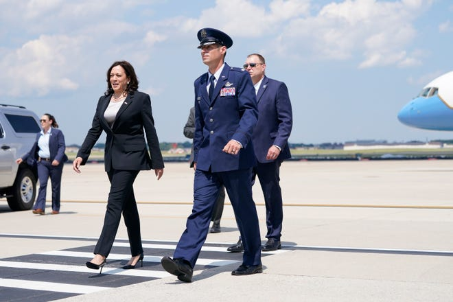 U.S. Air Force Lt. Col. escorts Vice President Kamala Harris after disembarking from Air Force One when a technical problem forced the plane to turn back and land at Andrews Air Force Base, Maryland, on June 6, 2021, as it was on its way to Guatemala City.