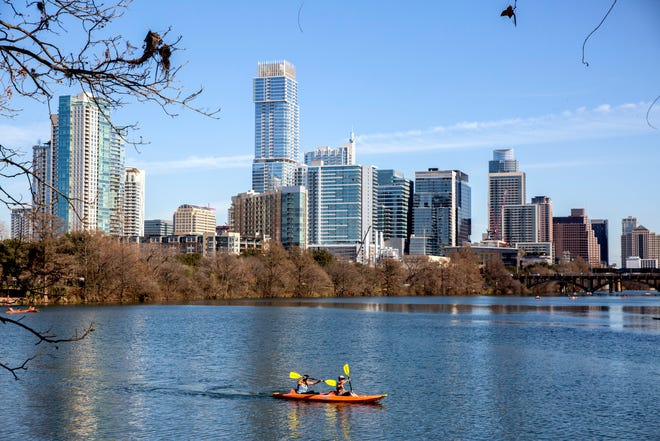 The Austin skyline as seen from Lou Neff Point off the Ann and Roy Butler Hike and Bike Trail in Austin on Monday, January 7, 2020. [BRONTE WITTPENN/AMERICAN-STATESMAN]