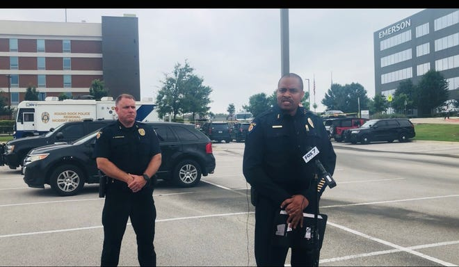 Round Rock Police Chief Allen Banks, right, and Assistant Chief Justin Carmichael provide details of an officer-involved shooting Monday at the Home2 Suites hotel.