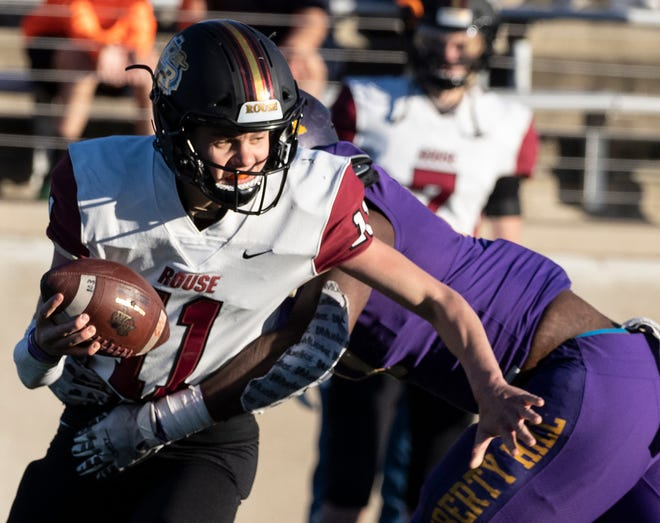 Rouse's Mason Shorb tries to scramble away from Liberty Hill's Lloyd Johnson Jr. during a playoff game last season. Shorb shredded defenses with 3,100 yards and 39 touchdowns as a sophomore, earning All-Centex Newcomer of the year from the American Statesman.